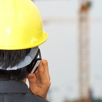 contractor-on-the-phone-inspecting-a-building-site_MkMCnND_